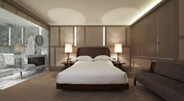 Master bedroom with luxury design has king size bed with floating wooden bed frame