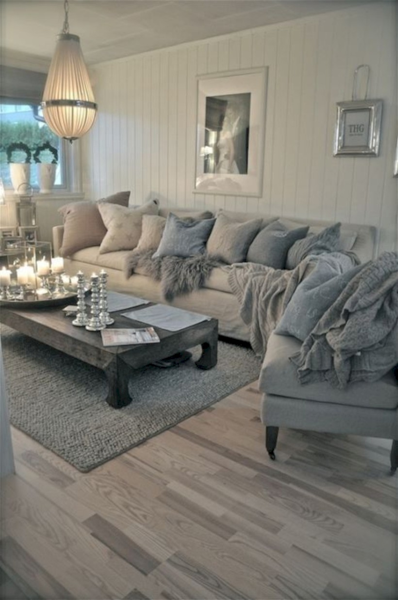 Neutral sectional sofa and rustic wood coffee table in the living room