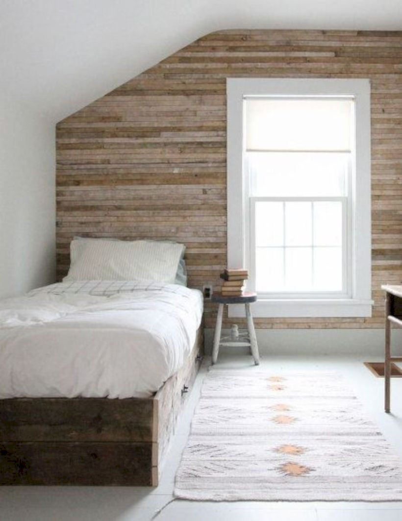 Attic bedroom with horizontal wood plank wall