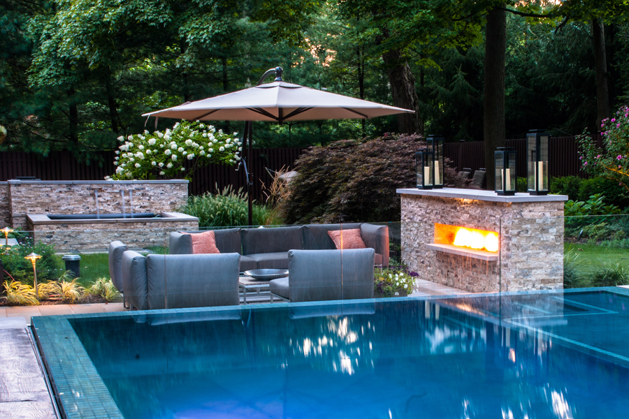 6. modern pool with fireplace