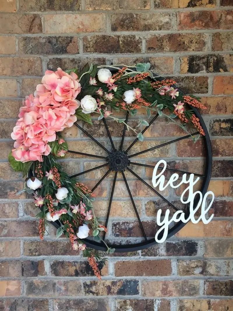 8. bicycle wheel wreath on the door
