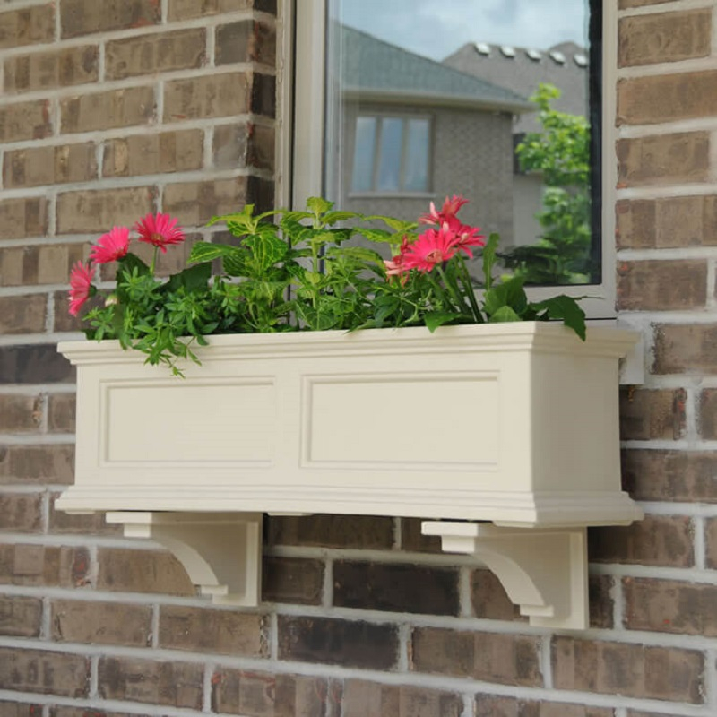 Cream colored flower box with moulding