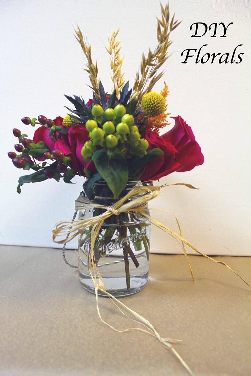 Mason jar arrangement with raffia bow