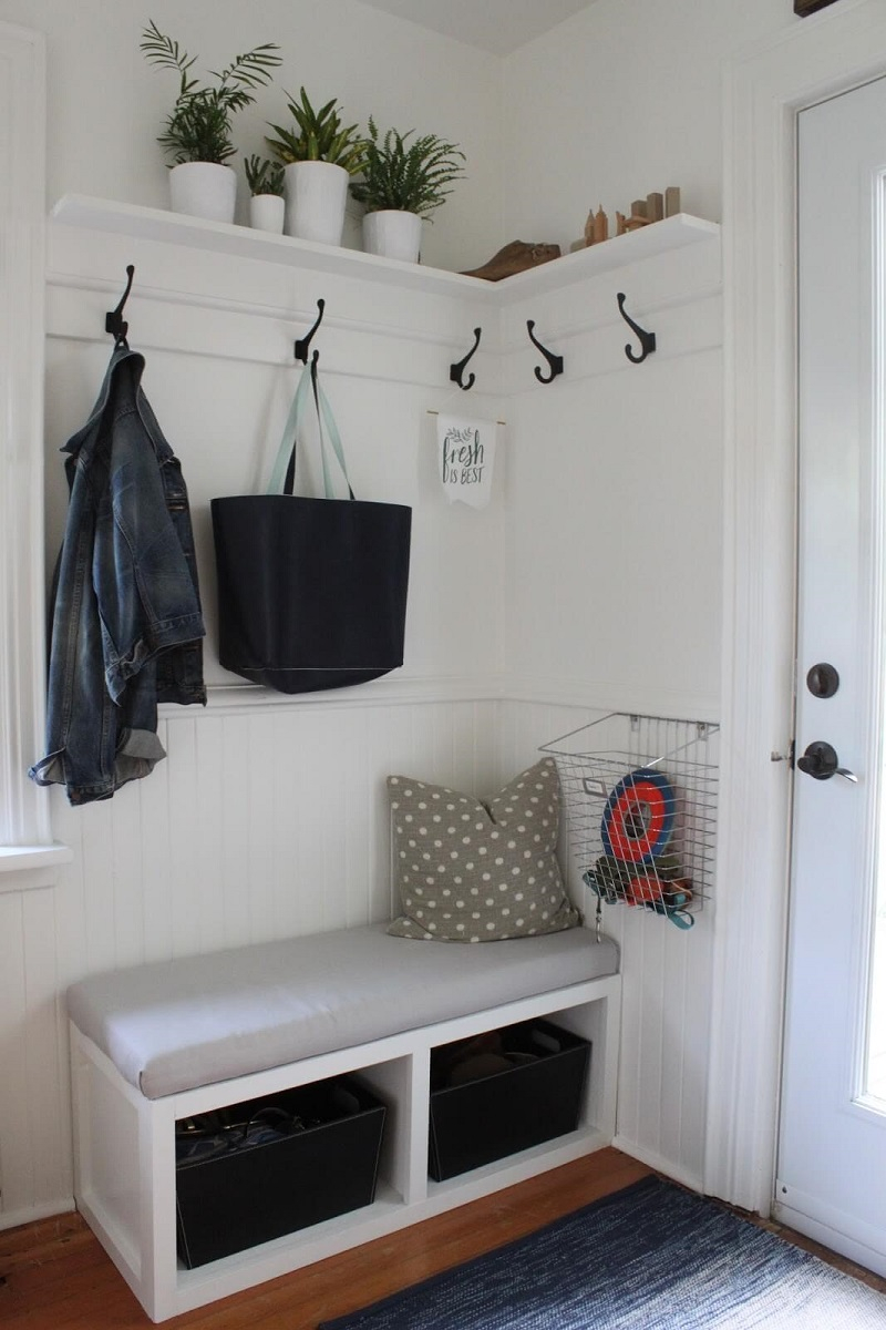 Storage bench with wall hooks