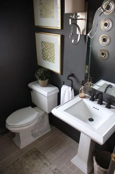 Elegant bathroom design with black walls 16