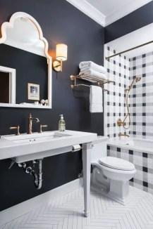 Elegant bathroom design with black walls 23