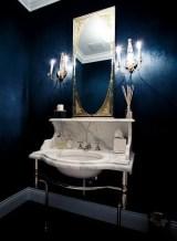 Elegant bathroom design with black walls 35