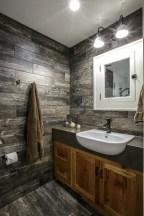 Elegant bathroom design with black walls 40