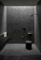 Elegant bathroom design with black walls 48