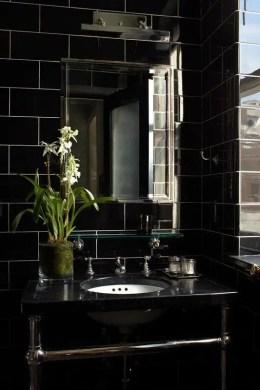 Elegant bathroom design with black walls 52