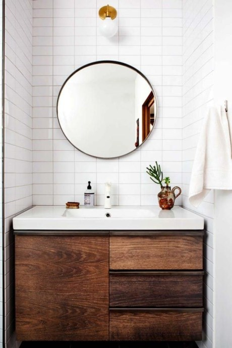 Adorable round mirror designs to brighten up your small space 11