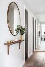 Adorable round mirror designs to brighten up your small space 20