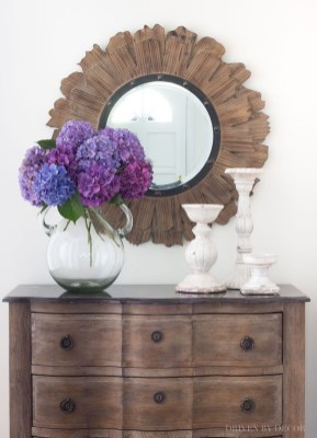Adorable round mirror designs to brighten up your small space 24