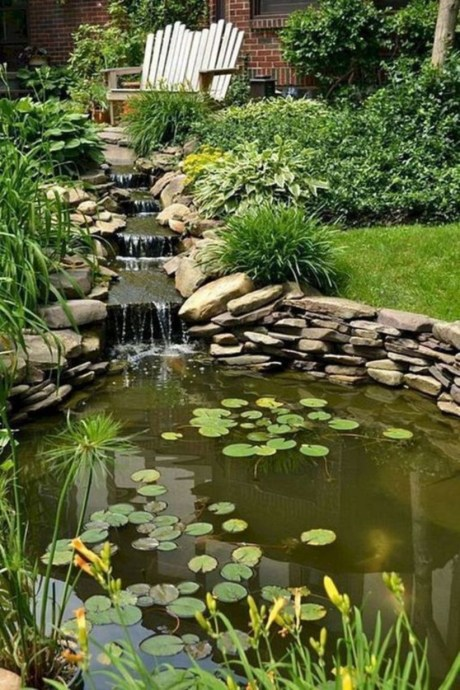 Design a fish pond garden with a waterfall concept 03
