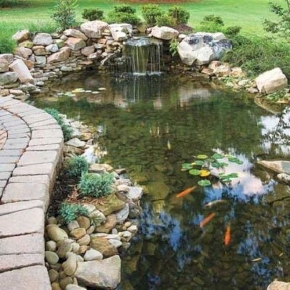 Design a fish pond garden with a waterfall concept 06