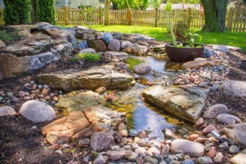 Design a fish pond garden with a waterfall concept 09