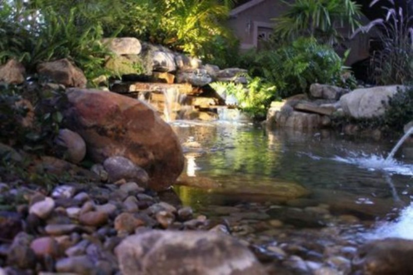 Design a fish pond garden with a waterfall concept 17