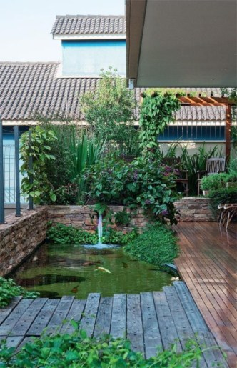 Design a fish pond garden with a waterfall concept 23