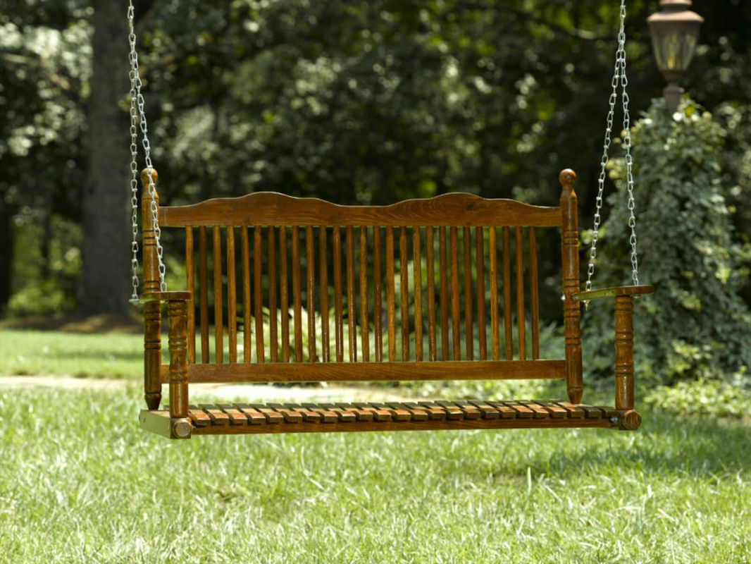 A classic bench seat swing with a finely crafted wood design to complete your summer garden