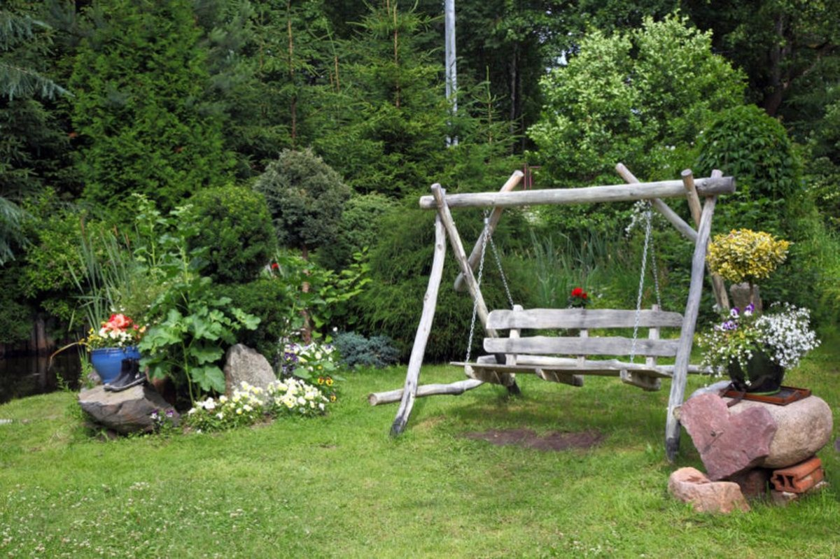 An amazing summer garden with a diy old wood swing to beautify your backyard