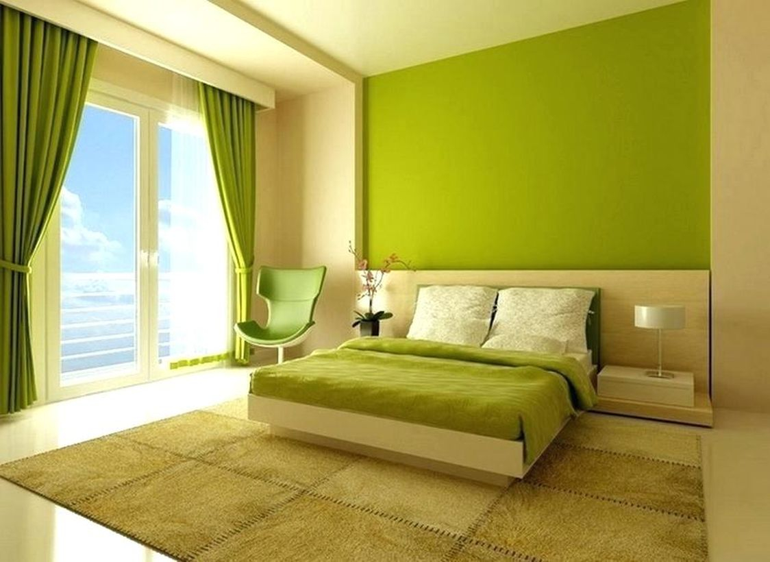 An amazing green bedrooms with a green wall, green curtains, green chairs, a brown carpets, a large windows that make the rooms bright