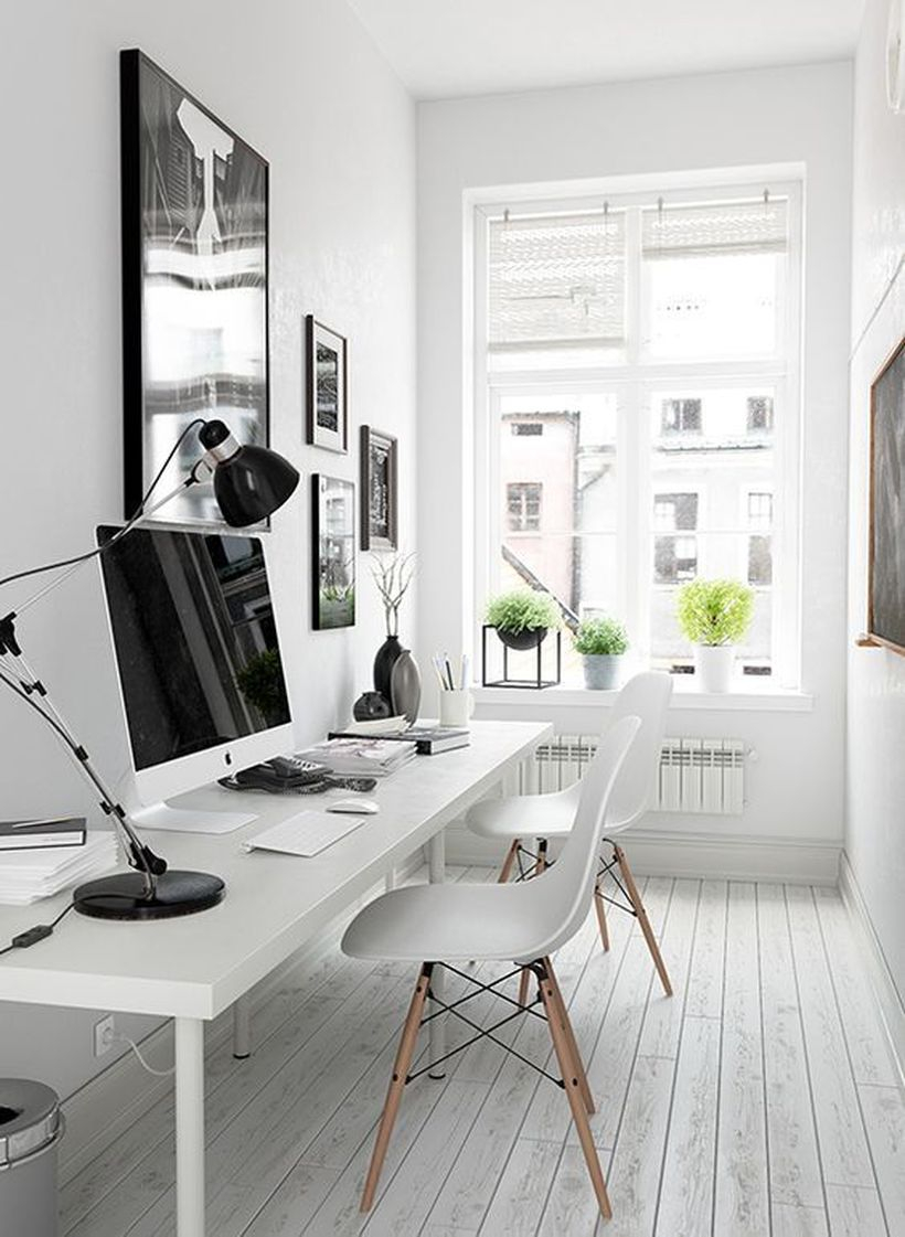 Interesting white work room with white walls, white chairs, white curtains from wood, plants and white wood floors that make you not get bored quickly