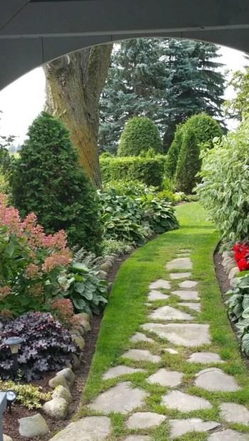 On budget garden walk path ideas for an easy movement around the garden 15