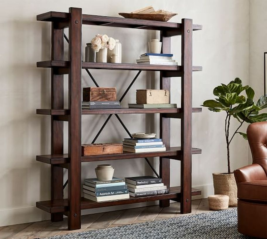 A creative storage made of teak wood furniture for vertical rack to store book and accessories