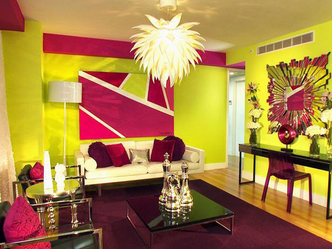 Stunning beautiful living room with splashes of yellow and purple pillows, purple, black square tables, wooden floors to create pleasurable
