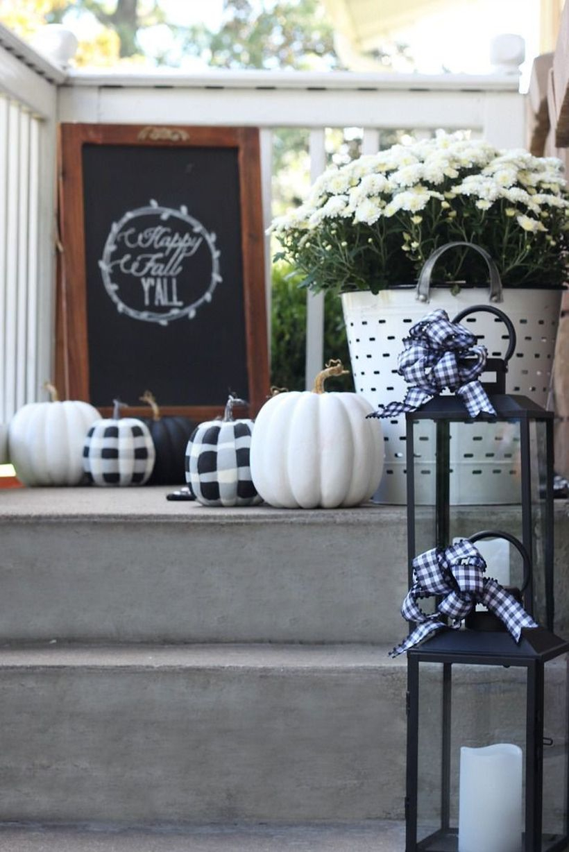 A attractive outdoor redecoration from summer to fall with versatile post painted pumpkins and seasonal signs, you can also instantly dress up your outdoor entryway with few cozy lanterns.