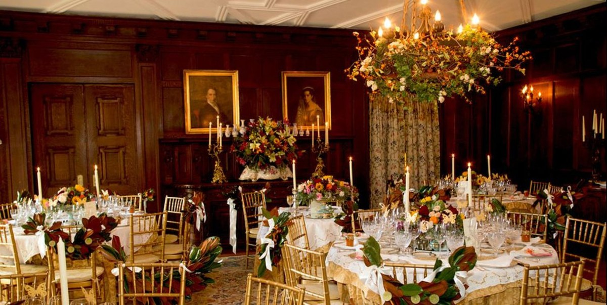A gorgeous indoor venue for fall wedding with blantyre estate featuring architecture such as castles and comfortable rooms for a fast autumn wedding.