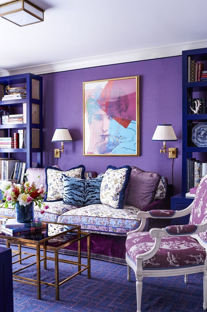 A wonderful home paint colors with mauve walls,velvet coated special sofa, a large carpet and table gold