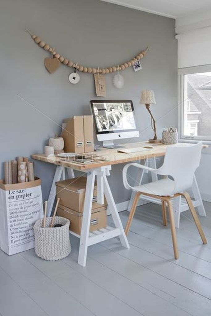 An amazing light subtle grey wall combined with wooden table and wall decoration to complete your neutral office home