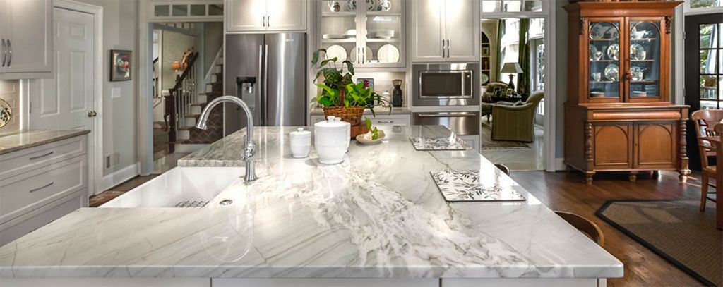 An amazing white granite kitchen countertops combined with wooden floor and plants decoration to complete your modern kitchen