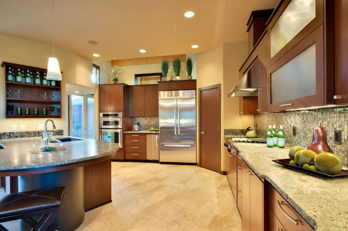 An attractive home paint colors with the room is surrounded by beige walls and lighted by recessed and pendant lights