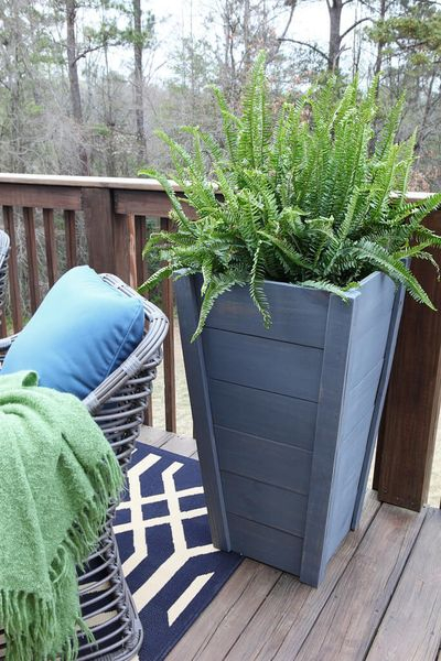 An awesome diy painted wood tall planter with blue paint to perfect your outdoor decoration