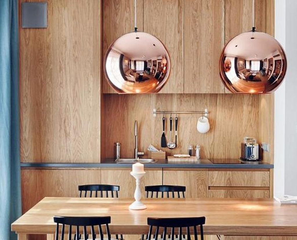 An awesome interior design trends for home with round copper hanging lamps above table to perfect your dining room