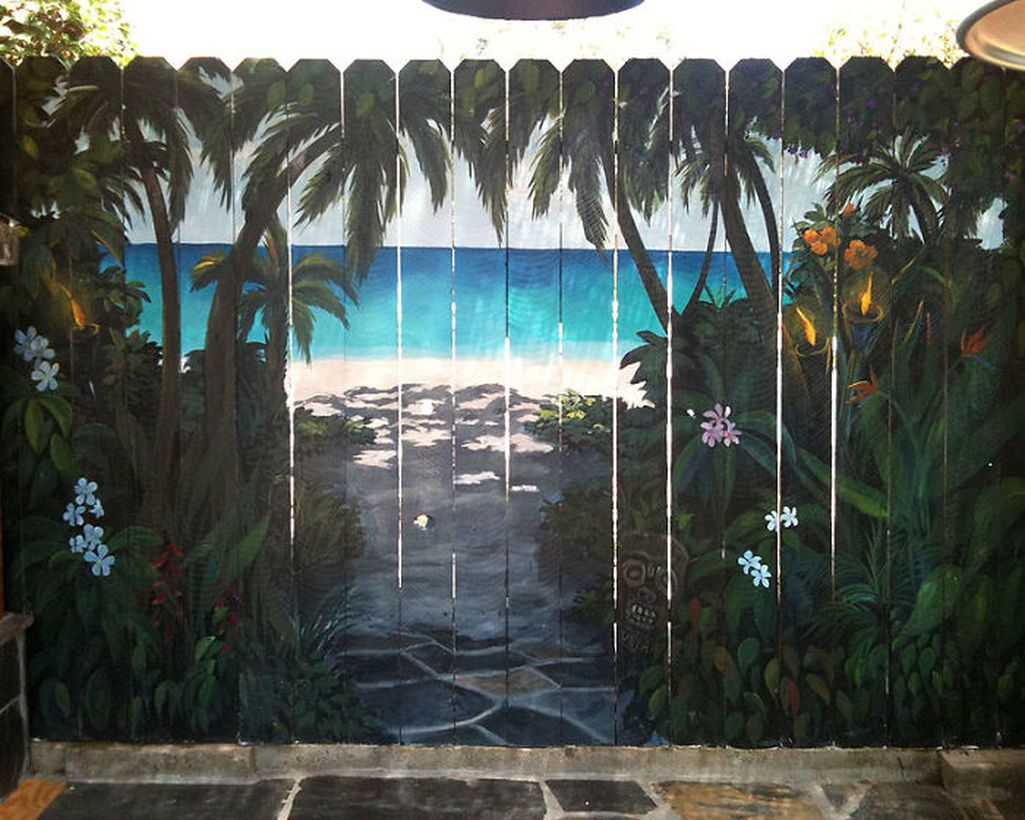 An awesome painting fence for garden with beach mural fence decor, a primer metal paint the top coat will last longer and the result is attractive.