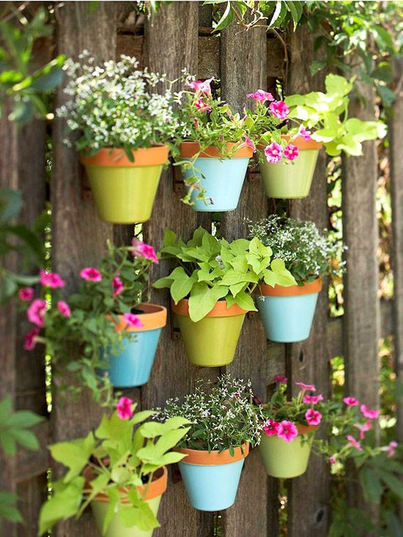 An awesome plant decoration for garden with terra cotta plant hangers that fence will come alive all the plants that you put in this is also a great project for those broken or chipped pots.