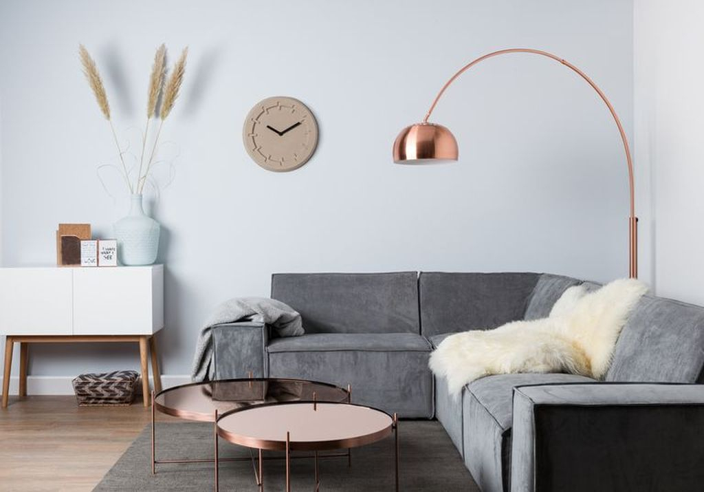 An elegant living room design with copper floor lamp and round copper table to perfect your living room design