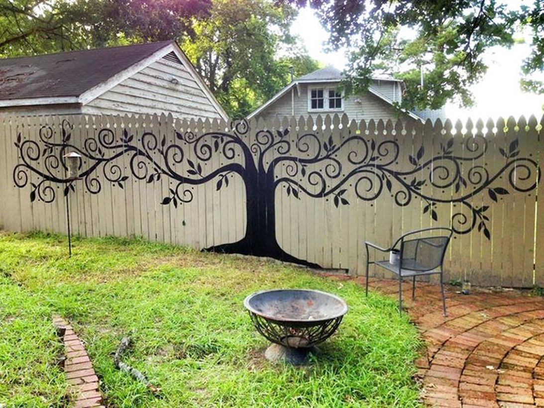 An impressive painting fence for garden with tree mural intricate paintings unique flower holders, these fences will sure make your neighbors jealous.
