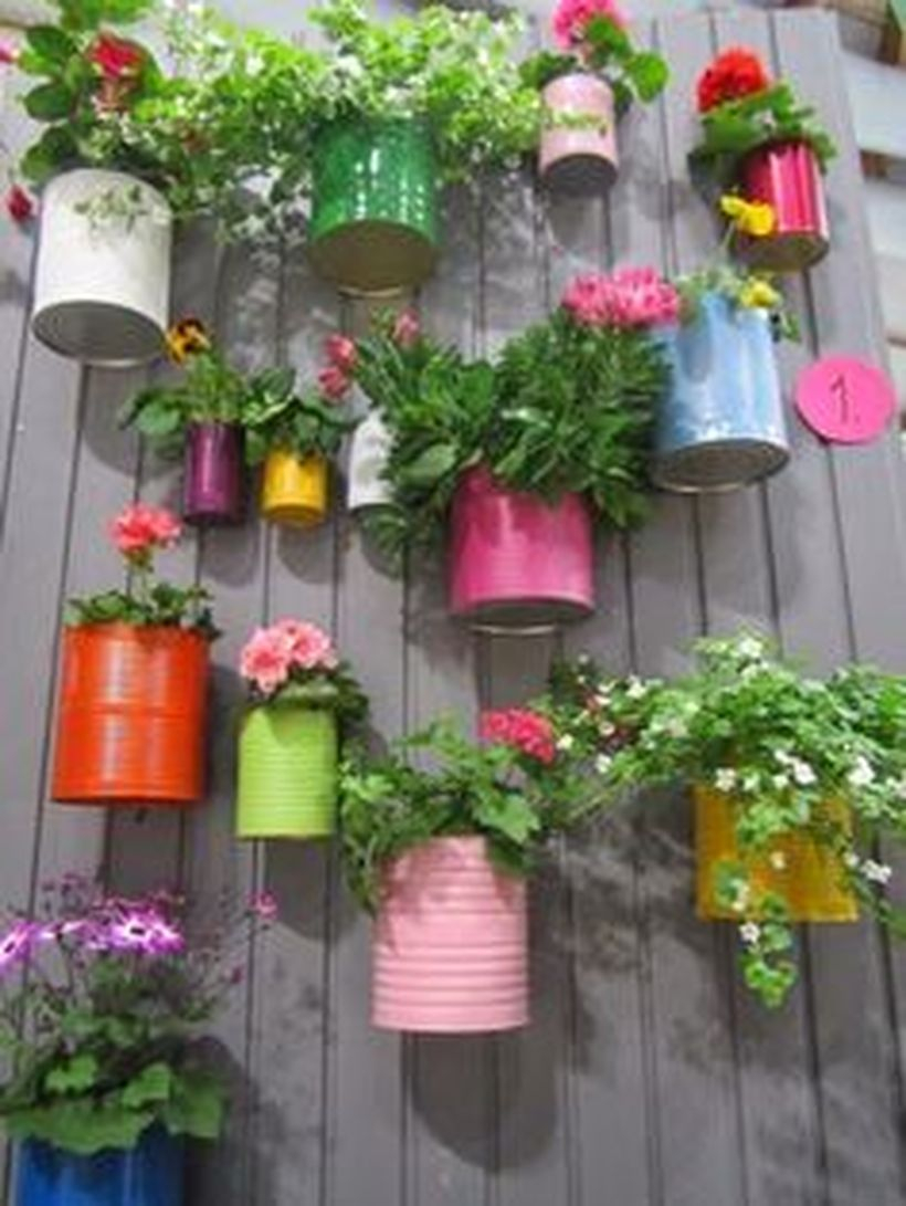 An impressive plant decoration for garden with you can paint those cans and turn them into beautiful planters your fence plant decoration for fence with colorful pot.
