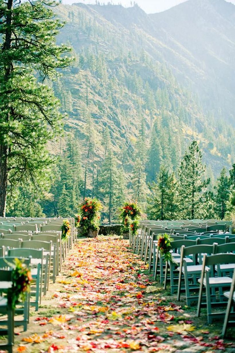 An incredible outdoor venue for fall wedding with weddings under pine trees are the perfect way to exchange vows on a beautiful mountain slope.