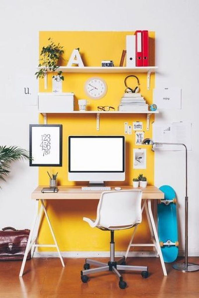 Beautiful white wall decoration combined with funky yellow accent to beautify your neutral office home