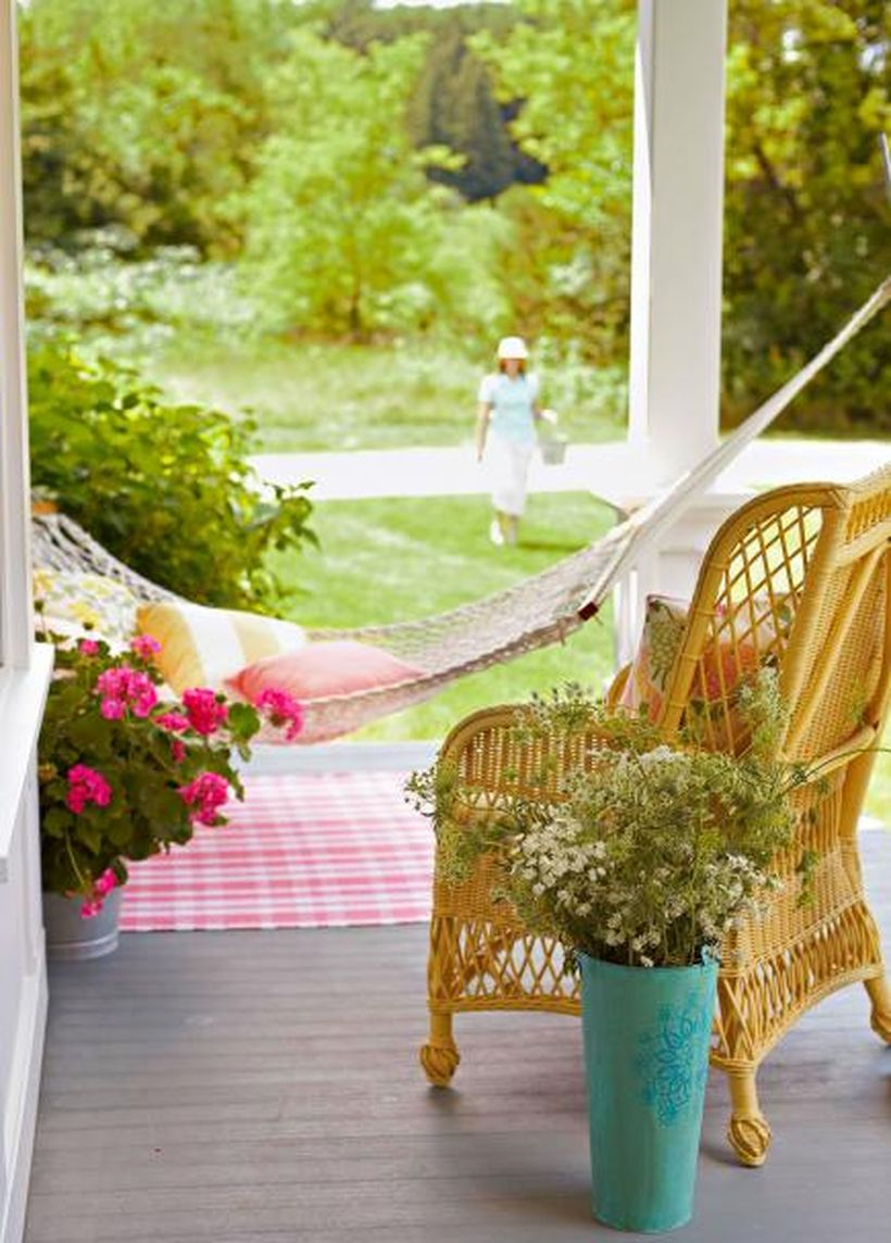 Cozy seating ideas with rattan chair, swing and pillows