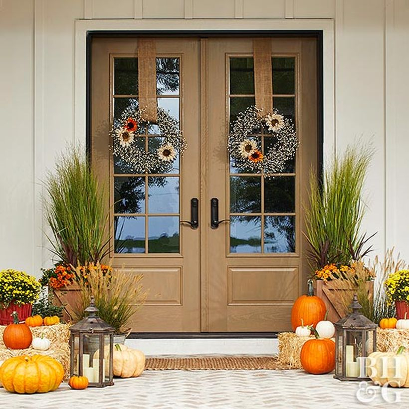 Interesting farmhouse porch ornament with plants in square wooden pot , pumpkins and candle lights