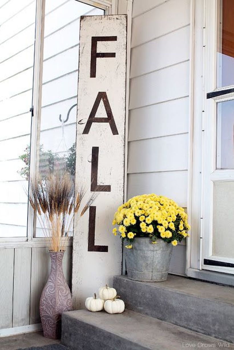 Interesting porch ideas fall welcome signs with white wooden slats, white pumpkin, yellow flower and reed plant