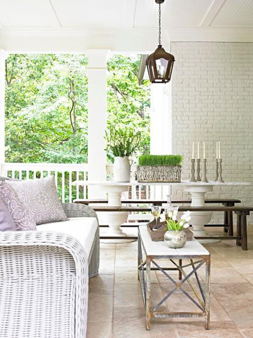 Interesting seating ideas with white rattan chair, white seat cushion and square wooden tables