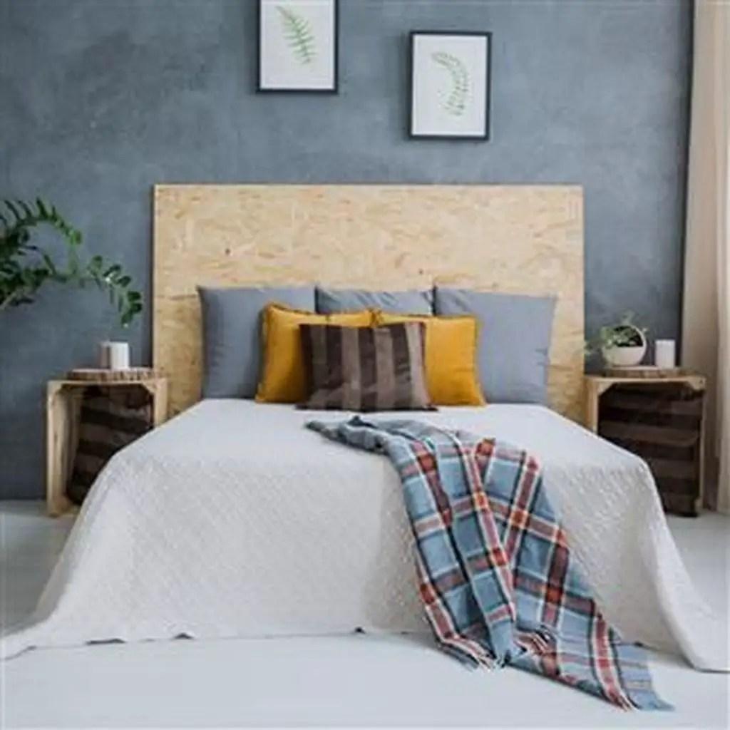 Modern bedroom with wooden headboard