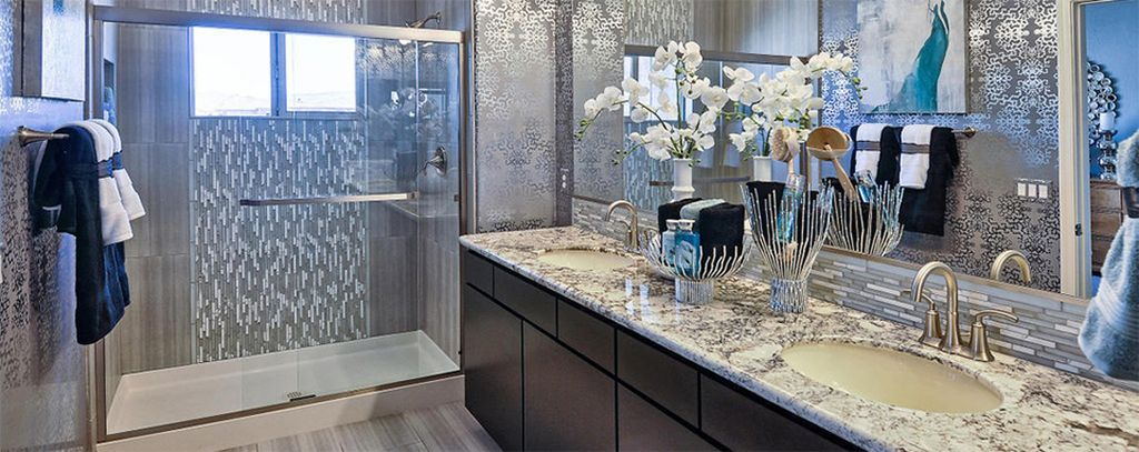 Perfect bathroom design combined with patterned granite cabinets and white flowers decoration to perfect your modern bathroom